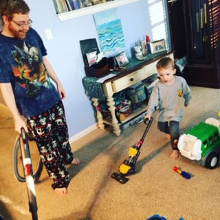 Bryan vacuuming-teaching kids about money