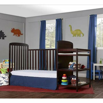 This stylish baby's room with a beautiful dark-colored crib and white walls looks clean and organized thanks to under-crib storage.