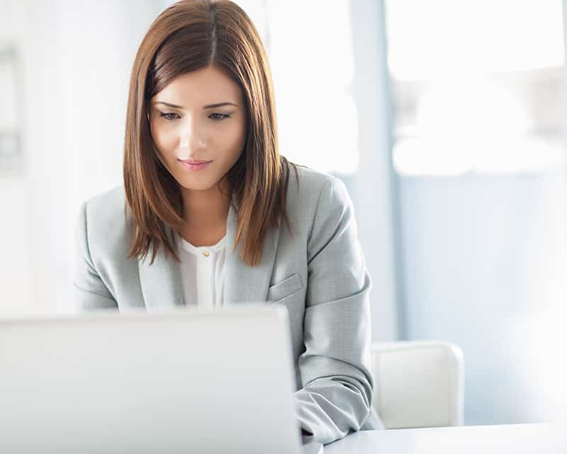Woman working and find best web hosting.