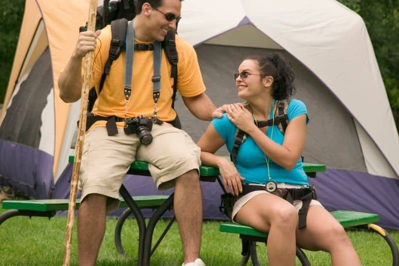 Couple going on a camping trip together on a free date idea.