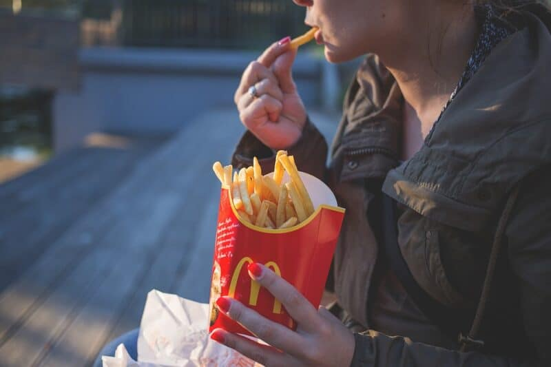 Can't stop eating handfuls of those fast-food French fries? Cravings are a sign of pregnancy.