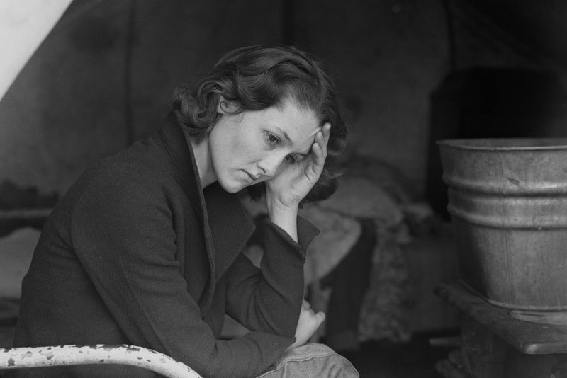 Woman in the great depression feeling sad.