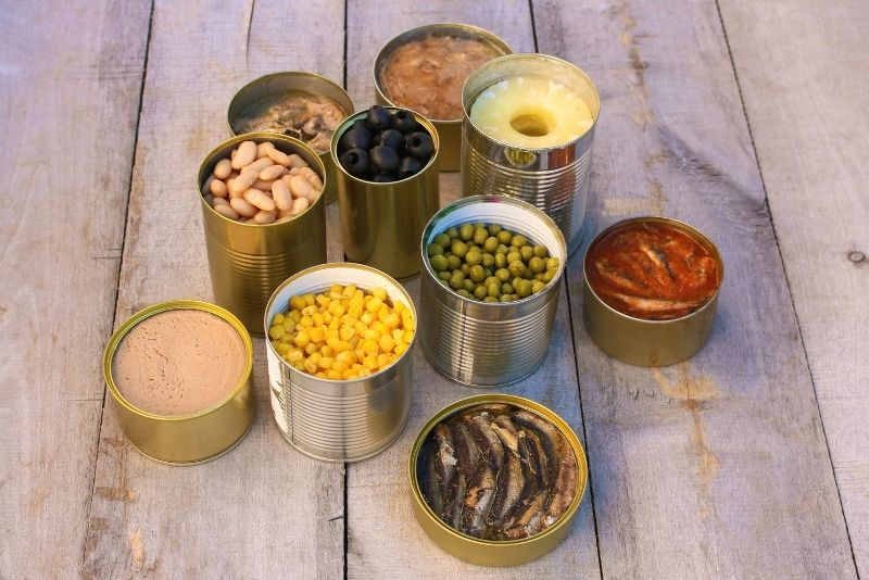 Several foods that are canned and preserved at home.