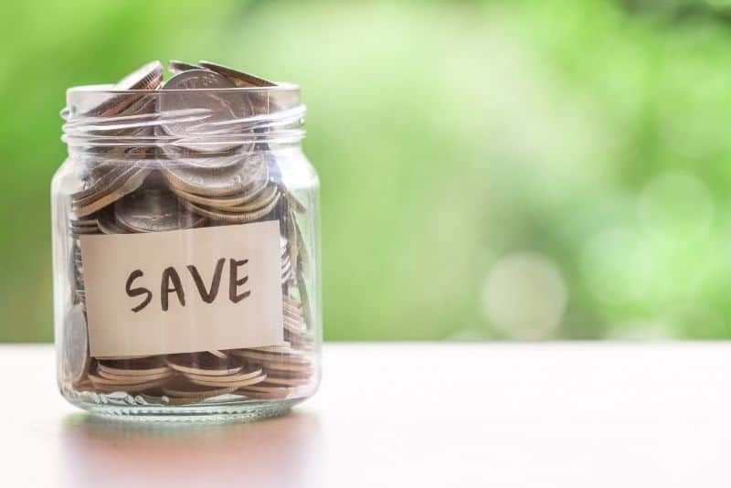 Money saved in a jar to build up wealth and prosperity.