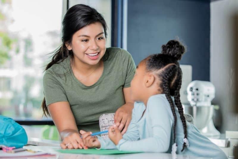 Woman teaching kid as a summer job for teachers.