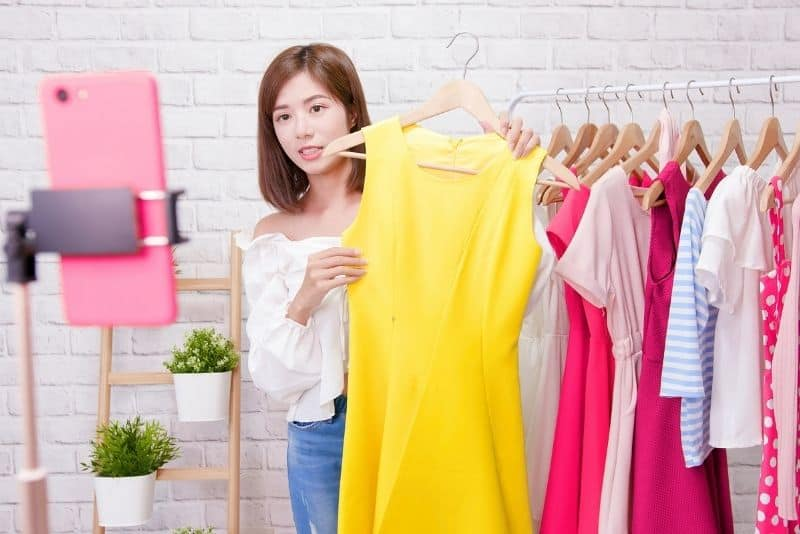 Woman selling her clothing to make money from home.