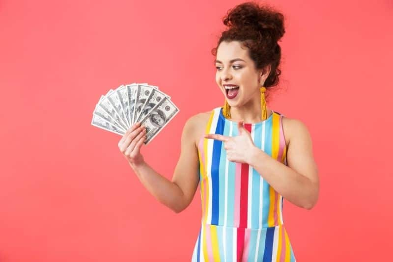 Woman with money that she made from selling things around her home.
